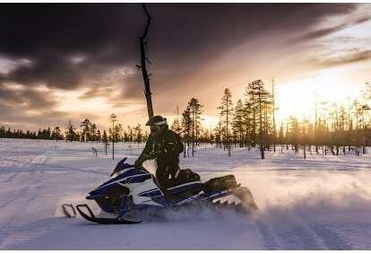 Izbrauciens ar sniega motociklu  Rīgā